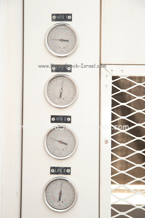 Close up of the pressure gauges of an air compressor