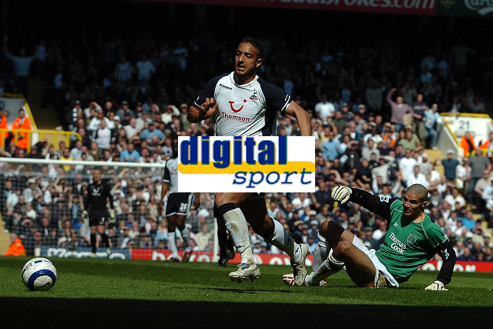 Photo: Ed Godden.<br />Tottenham Hotspur v Manchester City. The Barclays Premiership. 08/04/2006. Spurs' Mido (L) takes the ball round the Man City keeper David James, but fails to score.