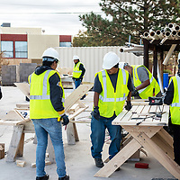 The first class of the Greater Gallup Economic Development Corporation's workforce development program works on building tables under the watchful eye of program manager Jonathan Gonzalez, left, out at the Southwest Indian Foundations warehouse in Gallup on Oct. 18.