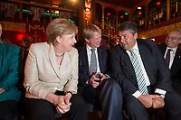 09 JUN 2015, BERLIN/GERMANY:<br /> Angela Merkel (L), CDU, Bundeskanzlerin, Reiner Hoffmann (M), Vorsitzender Deutscher Gewerkschaftsbund, DGB, und Sigmar Gabriel (R), SPD, Bundeswirtschaftsminister, im Gespraech, vor Beginn einer Veranstaltung der DGB anlaesslich des 60. Geburtstages von Reiner Hoffmann, Ballhaus Berlin<br /> IMAGE: 20150609-01-064<br /> KEYWORDS: Gespräch