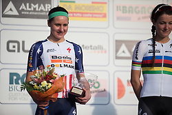 Megan Guarnier (Boels-Dolmans Cycling Team) smiles on the podium, after finishing second in the Trofeo Alfredo Binda - a 123.3km road race from Gavirate to Cittiglio on March 20th 2016.