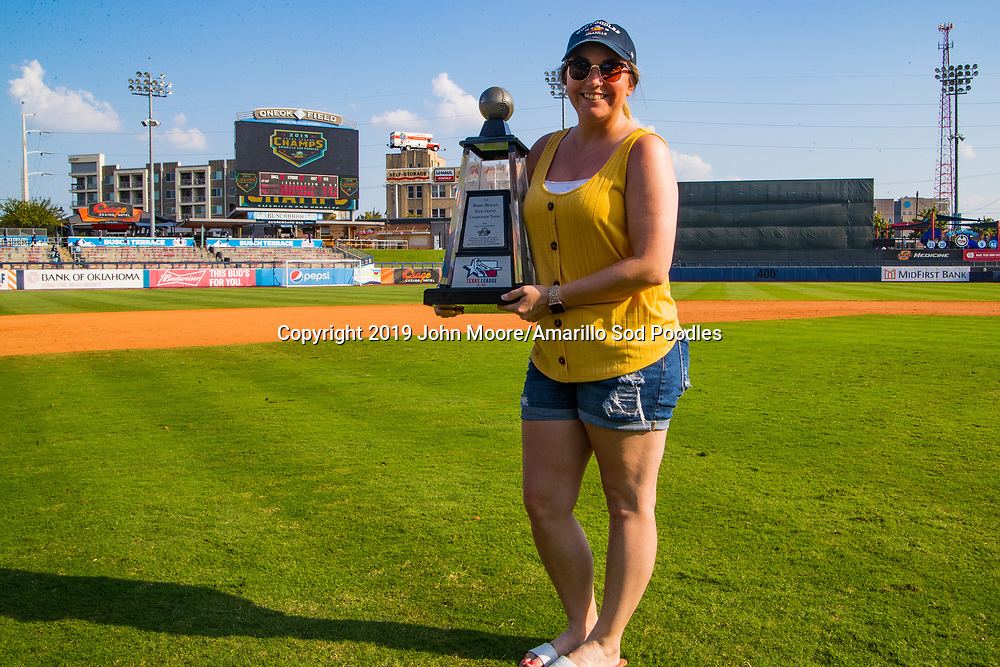 Katarina Burns poses with the trophy after the Sod Poodles won against the Tulsa Drillers during the Texas League Championship on Sunday, Sept. 15, 2019, at OneOK Field in Tulsa, Oklahoma. [Photo by John Moore/Amarillo Sod Poodles]