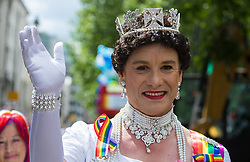 Portland Place, London, June 25th 2016. Dressed as the queen, a reveller waves at the camera as thousands of LGBT people and their supporters gather for Pride in London, a colourful celebration of the hard-won rights of lesbian, gay, bisexual and transgender  people.