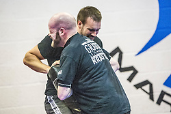Students practising their techniques with the pads. Stef Noij, KMG Instructor from the Institute Krav Maga Netherlands, takes the IKMS G Level Programme seminar today at the Scottish Martial Arts Centre, Alloa.