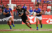 Samoa's Elisapeta Alofipo breaks past New Zealand's Dylan Collier during the HSBC Singapore Rugby Sevens 5th Place Play-off - Samoa v New Zealand won by Samoa 19-17 at The National Stadium, Singapore, Sunday, April 14th, 2019. (Steve Flynn/Image of Sport)