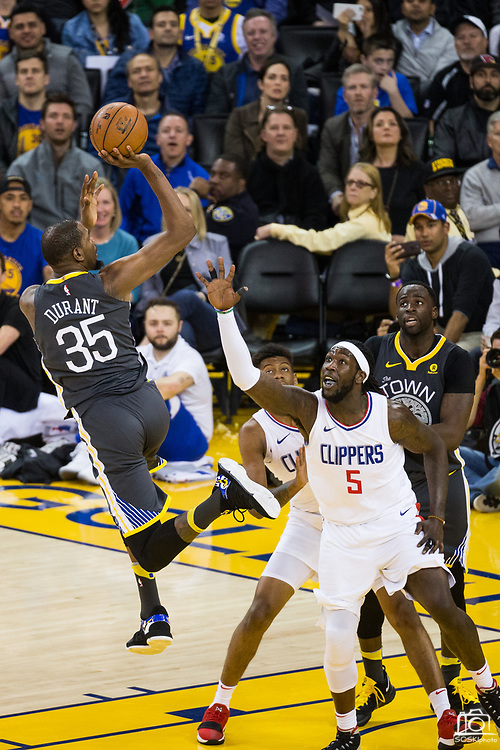 Golden State Warriors forward Kevin Durant (35) takes an off balance shot over the LA Clippers at Oracle Arena in Oakland, California, on February 22, 2018. (Stan Olszewski/Special to S.F. Examiner)