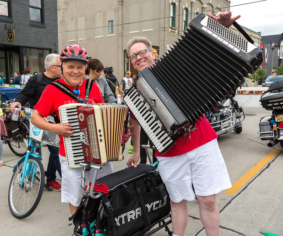 """Wisconsin Bike Federation Polish Moon Ride, June 22, 2018. Festivities at the start in front of the Fuel Cafe. As billed by WBF, the event is a slow-paced 8-mile ride through historic Polish neighborhoods through the """"Streets of Old Milwaukee."""""""
