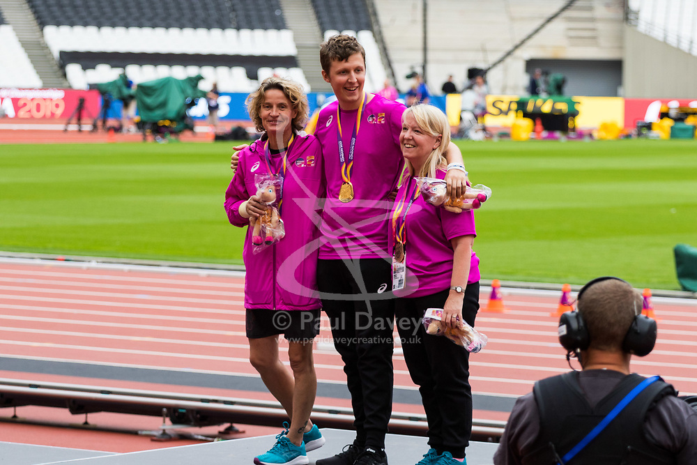 London, 03 August 2017. Volunteers stand on the podium as rehearsals are held for the medal ceremonies ahead of the IAAF World Championships London 2017 at the London Stadium.