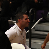Glenn Caruso chats with young fans after his program's quarterfinal victory over Wabash College.