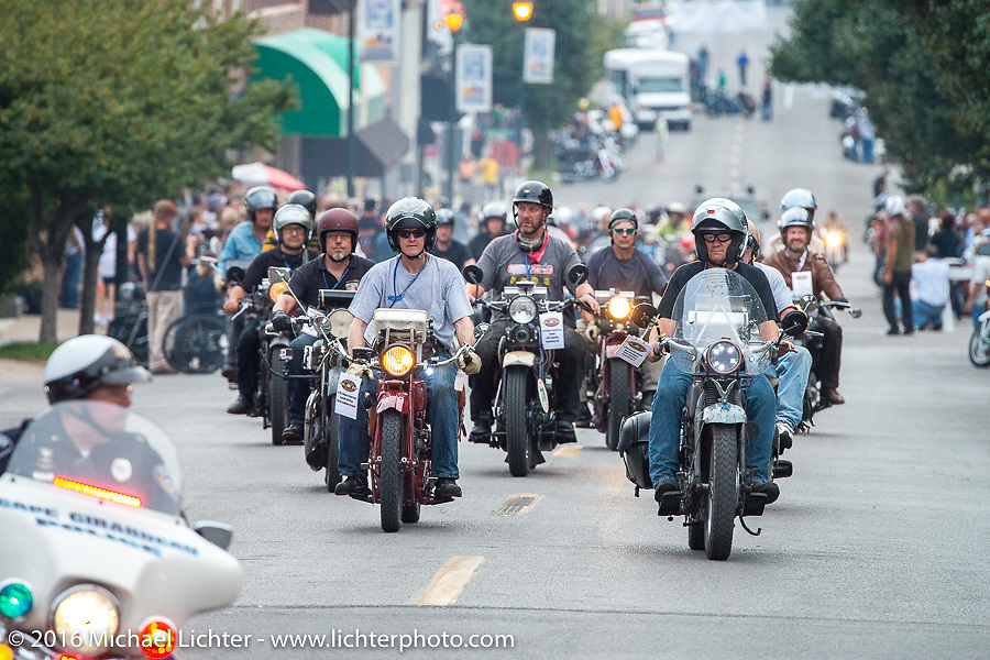 Parading up Spanish Street with a police escort after the hosted dinner stop in Cape Girardeau, Missouri during Stage 5 of the Motorcycle Cannonball Cross-Country Endurance Run, which on this day ran from Clarksville, TN to Cape Girardeau, MO., USA. Tuesday, September 9, 2014.  Photography ©2014 Michael Lichter.