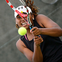 050913  Adron Gardner/Independent<br /> <br /> Grants Pirate Paris Corley keeps her eye on the ball battling Albuquerque Academy Charger Melissa Pick during the 4A Tennis State Championship championship match at the Jerry Cline Tennis Center in Albuquerque Thursday.