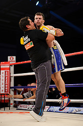 Lee Haskins celebrates victory over Luke Wilton with his trainer after their Bantamweight bout - Photo mandatory by-line: Rogan Thomson/JMP - Tel: 07966 386802 - 01/03/2014 - SPORT - BOXING - The City Academy, Bristol - James DeGale v Gevorg Khatchikian.