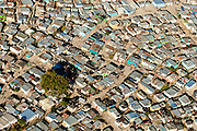 An aerial view of a township taken over the Cape Flats near Cape Town. An aerial image by Greg Beadle