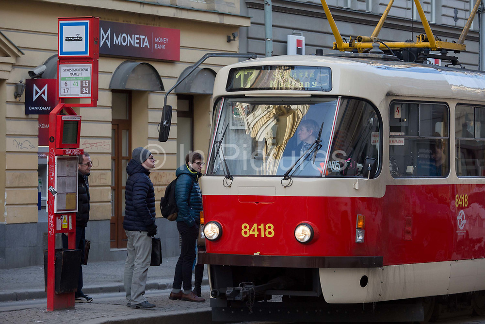 Passengers board a tram on Milady Horakove street, Holesovice district, Prague 7, on 19th March, 2018, in Prague, the Czech Republic.