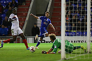 Ryan Flynn of Oldham Athletic has a shot saved by Jussi Jääskeläinen of Wigan Athletic during the EFL Cup match between Oldham Athletic and Wigan Athletic at Boundary Park, Oldham, England on 9 August 2016. Photo by Simon Brady.