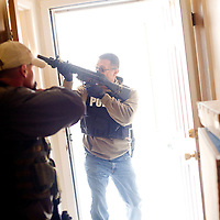 012513       Brian Leddy<br /> Gallup Police Detective Victor Rodriguez practices search and sweep techniques during a training exercise Friday.