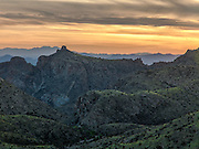 A colorful Tucson sunset viewed over Thimble Peak in the Santa Catalina Mountains.  Kitt Peak with its observatory can just be resolved in the background, left of the thimble.