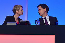 © Licensed to London News Pictures. 03/10/2012. Manchester, UK Leader of the Labour Party, Ed Miliband talks to Yvette Cooper, Shadow Home Secretary, on Day 4 at The Labour Party Conference at Manchester Central today 3rd october 2012. Photo credit : Stephen Simpson/LNP