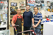 Jason Tran (left), Francis Landice (center), and Peter Nugyen (right) of Sun Bike Shop in Milpitas, Calif., pose for a photo on Sept. 18, 2012.  Photo by Stan Olszewski/SOSKIphoto.
