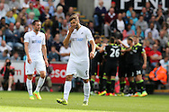 Fernando Llorente of Swansea city © looks dejected as Chelsea players celebrate after Diego Costa scores his teams 1st goal. Premier league match, Swansea city v Chelsea at the Liberty Stadium in Swansea, South Wales on Sunday 11th Sept 2016.<br /> pic by  Andrew Orchard, Andrew Orchard sports photography.