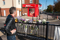 © Licensed to London News Pictures. 02/11/2018. Bellingham, Police are investigating after a teenager is fatally stabbed in Bellingham. Police have taped off a burger shop called Morleys.Flowers opposite Morleys. Photo credit: Grant Falvey/LNP