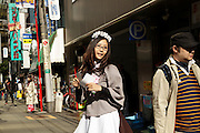 anime dressed up girl in Akihabara district in Tokyo handing out flyers
