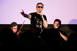 """© Licensed to London News Pictures . 14/08/2015 . Manchester , UK . Poet MIKE GARRY performs single """" St Anthony : an ode to Anthony H Wilson """" , written by Garry and composer Joe Duddell , with the Cassia String Quartet . A tribute to Tony Wilson at Old Granada Studios . Photo credit : Joel Goodman/LNP"""