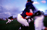 The New York Gems, a women's tackle football team, practice on a municipal field in Hempstead, New York, Saturday, September 30, 200.  They learn to tackle here for the first time.