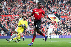 Manchester United's Paul Pogba reacts after seeing his shot on goal saved by Liverpool goalkeeper Alisson Becker during the Premier League match at Old Trafford, Manchester.
