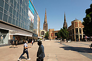 Broadgate in the UK City of Culture 2021 on 23rd June 2021 in Coventry, United Kingdom. Two of Coventrys famous spires can be seen here, including that of Coventry Cathedral. The UK City of Culture is a designation given to a city in the United Kingdom for a period of one year. The aim of the initiative, which is administered by the Department for Digital, Culture, Media and Sport. Coventry is a city which is under a large scale and current regeneration.