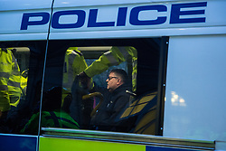 London, UK. 13th March, 2019. A pro-Brexit Yellow Vests UK activist is questioned in a Metropolitan Police vehicle in Westminster on the evening of the vote on a 'No Deal' Brexit in the House of Commons.
