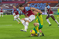 Dara O'Shea (27) of West Bromwich Albion slides in to tackle Aaron Cresswell (3) of West Ham United during the Premier League match between West Ham United and West Bromwich Albion at the London Stadium, London, England on 19 January 2021.
