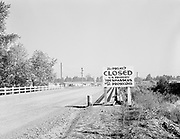"ackroyd-00022-44.  East Vanport. ""Vanport area slums"". Entrance sign ""This Project Closed. U. S. Property. Trespassers will be Prosecuted. October 13, 1946"