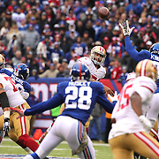 San Francisco 49ers quarterback Colin Kaepernick throws a pass during the New York Giants V San Francisco 49ers, NFL American Football match at MetLife Stadium, East Rutherford, NJ, USA. 16th November 2014. Photo Tim Clayton