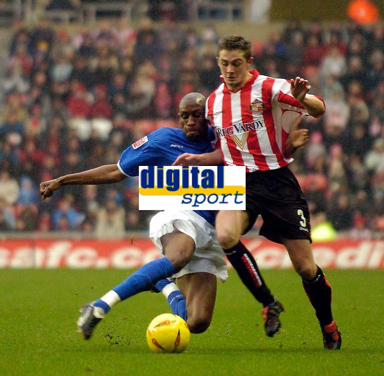Fotball<br /> England 2004/2005<br /> Foto: SBI/Digitalsport<br /> NORWAY ONLY<br /> <br /> Sunderland v Ipswich<br /> Coca-Cola Championship, 21/11/2004<br /> <br /> Sunderland's George McCartney (R) is tackled by Ipswich's Drissa Diallo