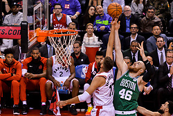 October 19, 2018 - Toronto, Ontario, Canada - oronto Raptors center Jonas Valanciunas (17) and Boston Celtics center Aron Baynes (46) reach for the ball during the Toronto Raptors vs Boston Celtics NBA regular season game at Scotiabank Arena on October 19, 2018 in Toronto, Canada (Toronto Raptors win 113-101) (Credit Image: © Anatoliy Cherkasov/NurPhoto via ZUMA Press)