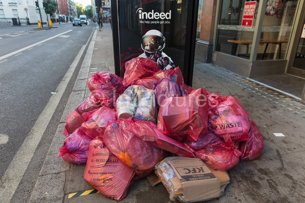 Rubbish left by a bus stop at the end of lockdown on 15th June in Southampton Row, London, United Kingdom.