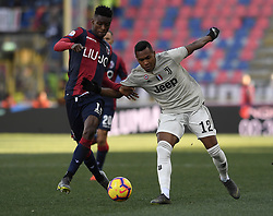 BOLOGNA, Feb. 25, 2019  Juventus's Alex Sandro (R) vies with Bologna's Ibrahima Mbaye during a Serie A soccer match between Bologna and FC Juventus in Bologna, Italy, Feb. 24 , 2019. FC Juventus won 1-0. (Credit Image: © Augusto Casasoli/Xinhua via ZUMA Wire)