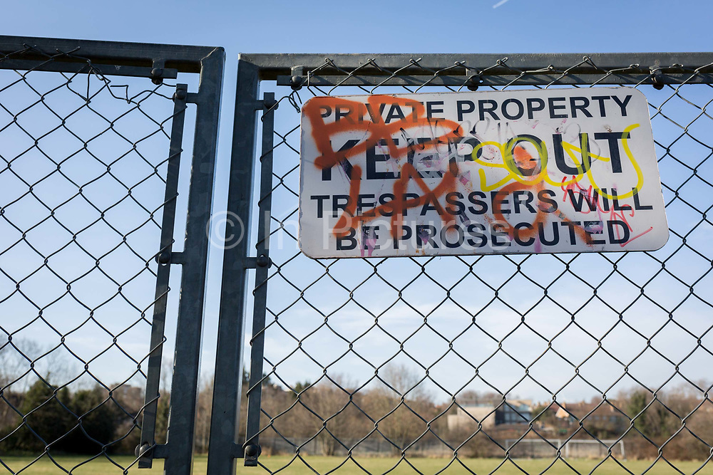 A Private Property Keep Out Trespassers Will Be Prosecuted sign on a chain fence, in the borough of Southwark, on 24th February 2018, in south London, England.
