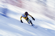 Blurred action of snowboarder racing downhill