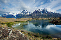 A beautiful mid day sky highlights the peaks of Torres del Paine. Patagonia, Chile