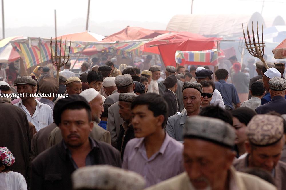 Busy famous Sunday Market in Kashgar , Xinjinag Province, China