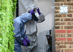 © Licensed to London News Pictures. 30/08/2012. London, UK  Scenes of crimes officers enter the house. A street cleaner has suffered potentially life threatening after being stabbed when disturbing a burglary in Shepherds Bush in West London today 30 August 2012. Photo credit : Stephen Simpson/LNP