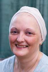 Woman; who has been undergoing Chemotherapy for breast cancer; wearing a towling turban to cover up hair loss as a result of the treatment,