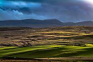 Roberton, Hawick, Scottish Borders, Scotland, UK. 19th December 2020. Heavy rain blows across the Hawick hills west of Roberton village.