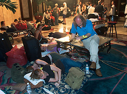 01 Sept, 2005. New Orleans, Louisiana.<br /> Mass evacuation begins. Foreign tourists await evacuation from the Hyatt Hotel in busses set up by the German consul in Houston. <br /> Photo©; Charlie Varley/varleypix.com