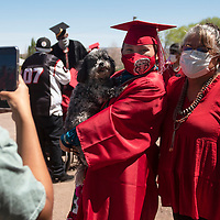 UNM-Gallup graduate Sherika Watchman poses with her dog Zoey and her mom Velma Miller as her best friend Valarie Lowe takes their photo following the University of New Mexico-Gallup Spring 2021 commencement ceremony at Angelo DiPaolo Memorial Stadium in Gallup Friday morning.