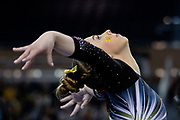 Natalie Wojcik of the Michigan Wolverines poses after landing during warm ups before the NCAA Regional meet at Crisler Center on April 5, 2019 in Ann Arbor, Michigan.
