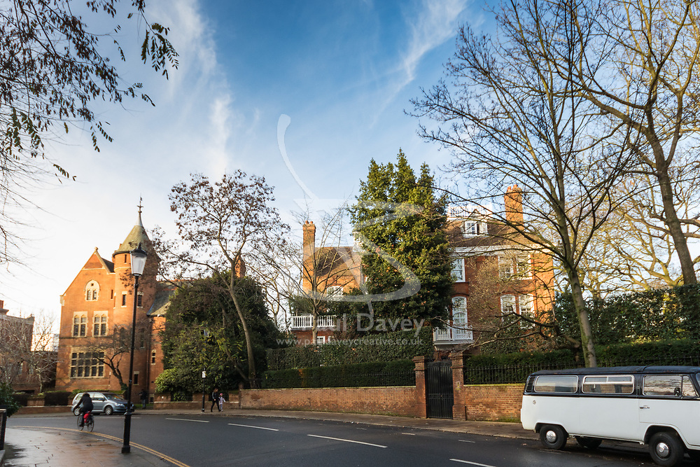 Jimmy Page's Grade I listed Tower House with Robbie Williams' property that he bought from the late film Director Michael Winner, right, in Melbury Road, where Led Zeppelin guitarist Page and the Solo mega-star and former Take That member are locked in a bitter planning dispute over Williams' plans for an 'iceberg' basement under his home in West London's posh Holland Park. London, December 17 2018.