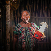 """""""Solar Mama"""" Kingaline, 44, holds her solar lamp. Dubbed the """"Solar Mamas,"""" these women were the first in their village to join a program by the World Wildlife Fund (WWF) to become electric engineers capable of installing and repairing solar panels. <br /> Across much of this African nation, where 77% of the population of 21 million has no access to electricity -- a figure rising to a staggering 94% among the rural population  -- nighttime means the burning of kerosene lamps and diesel engines, which fill the houses with toxic smoke. And it means the destruction of forests for firewood in one of the world's most biologically-diverse habitats. <br /> <br /> Darkness also brings the threat of crime, violence and accidents.<br /> <br /> Madagascar is the world's forth largest island off the coast of east Africa."""